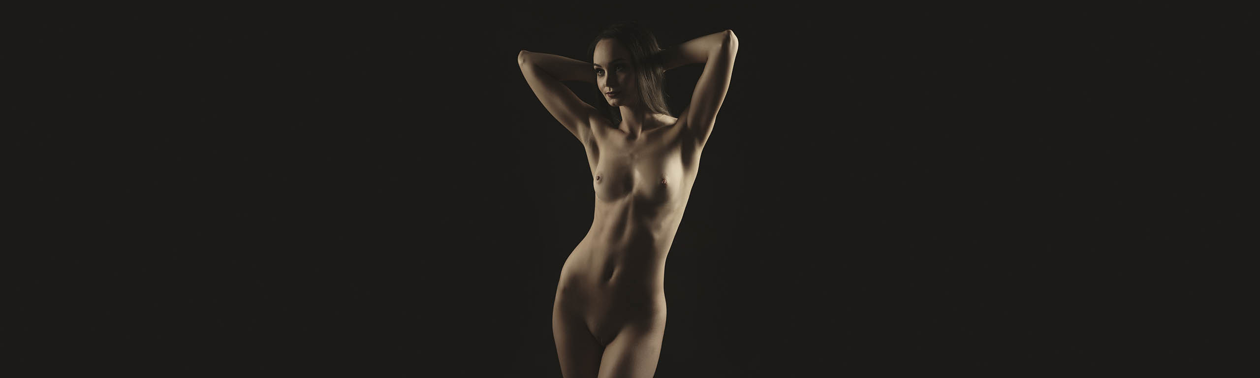 Nude photography of woman standing